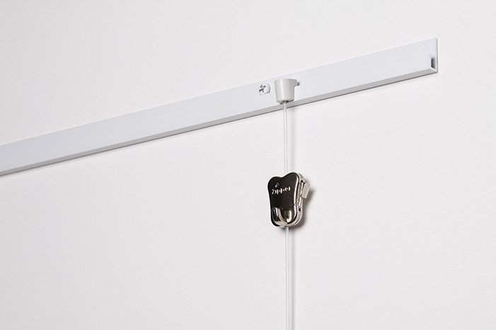 STAS j-rail white on wall with disk and perlon cord with zipper